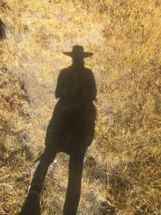 shadow of woman with hat on