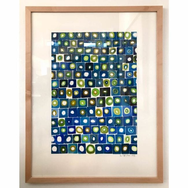 blue and green grid squares with circles inside watercolor painting in frame