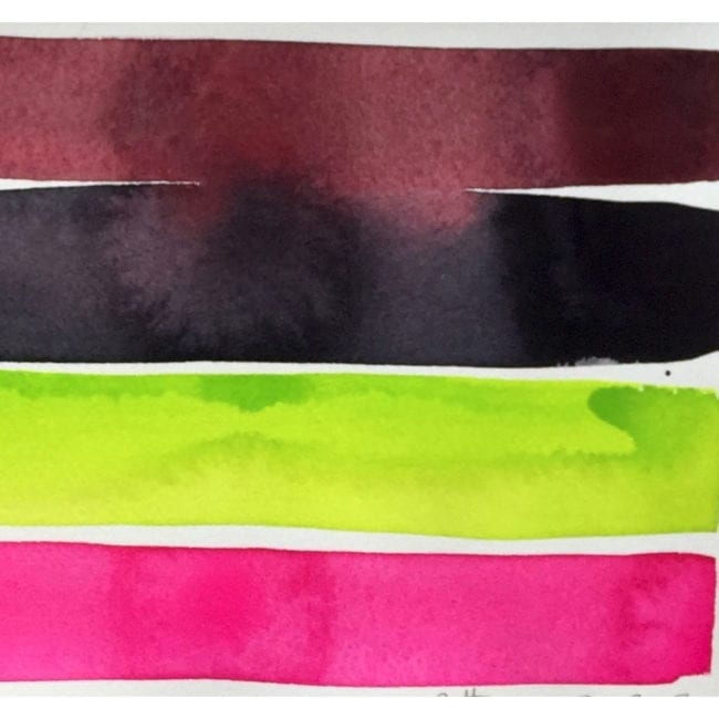 close up of brown, black, bright green, and hot pink strips with the brown and black stripes bleeding together