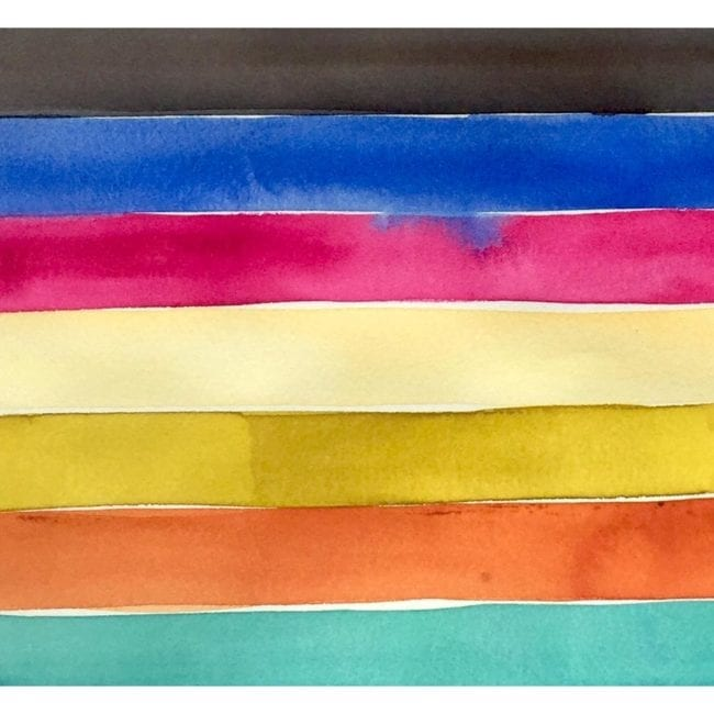 close up of a galapagos island watercolor painting color study of black, blue, pink, yellow, orange, and turquoise horizontal stripes with the blue strip bleeding into the hot pink