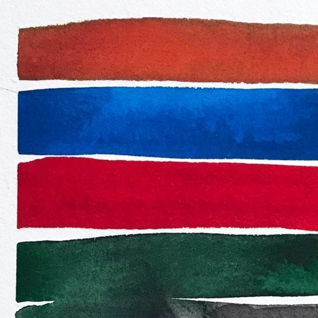 close up of the watercolor color study with a dark orange, deep blue, bright red, dark green, and dark gray horizontal stripes with the green stripe bleeding into the gray