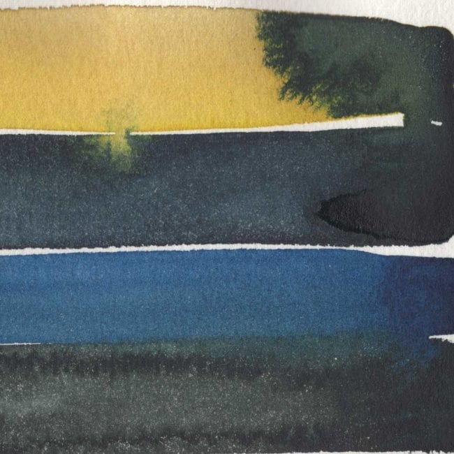 closeup of yellow black and blue stripes with black bleeding into yellow stripe