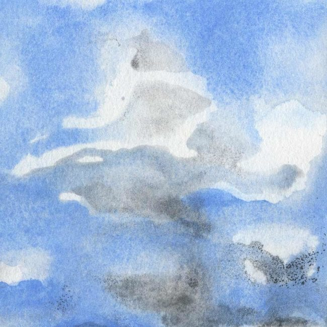 stormy dark clouds with various white highlights with blue background