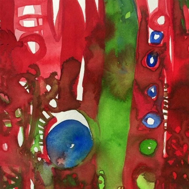 close up of a red, green, and blue watercolor painting depicting fire on a mountain through circles, short parallel lines, and large vertical lines