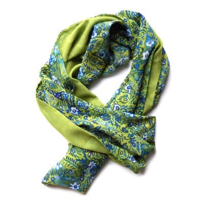long narrow chiffon scarf with green, blue and white floral pattern on one side and solid lemongrass color on the reverse