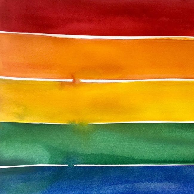 close up of the watercolor painting of red, orange, yellow, green, blue, and purple stripes inspired by the pride flag