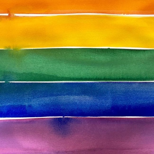 close up of the watercolor painting of red, orange, yellow, green, blue, and purple stripes inspired by the pride flag with the blue stripe bleeding into the purple one