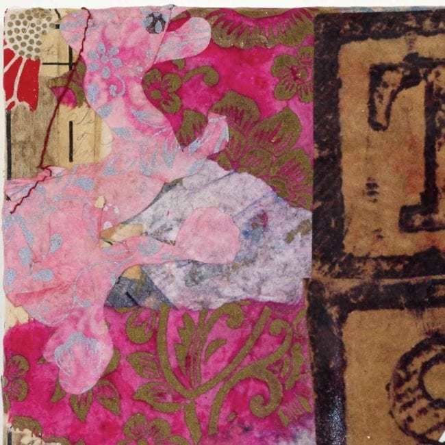 close up of a mixed media collage panel with torn pink and white patterned paper in the background showing the edge of the block letters T and S