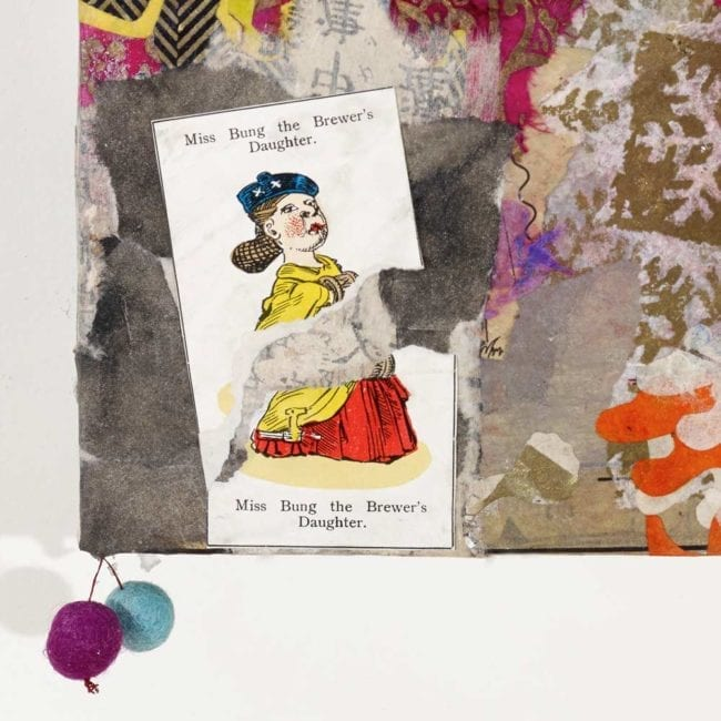 close up of a mixed media collage panel with torn pink and white patterned paper in the background showing a torn yellow and red illustration of miss bung the brewer's daughter as well as two pom-poms hanging by a string from the corner of the piece