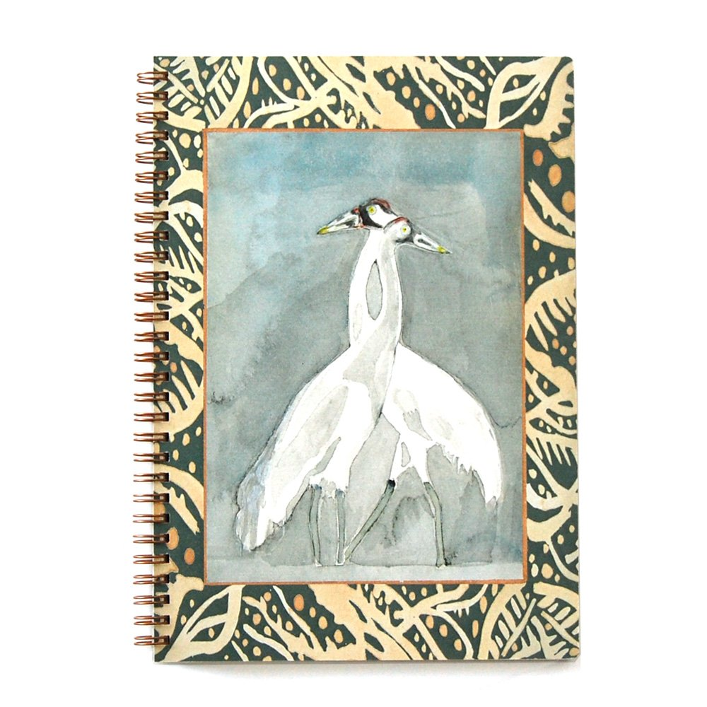 wire bound notebook with watercolor painting of cranes and a green and light yellow seagrass border