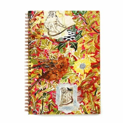 wire bound notebook with vibrant jungle watercolor and collage in red and gold jewel toes with a bird, monkeys and flora