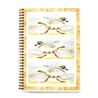 wire bound notebook with piping plovers running and a geometric border