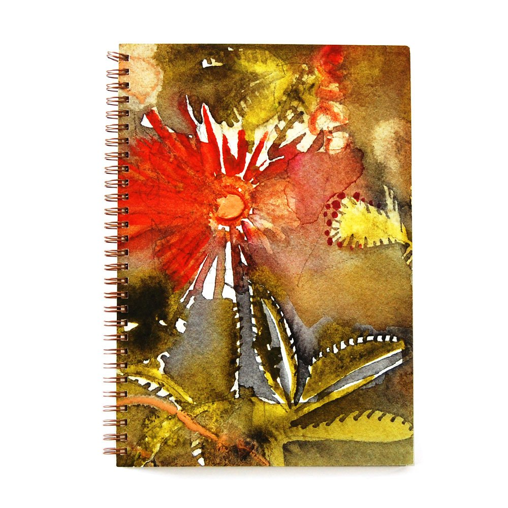 top view of a wire bound notebook with an abstracted flower in red with a green and yellow watercolor background