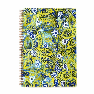 top view of a wire bound notebook with a vibrant green blue and white floral pattern