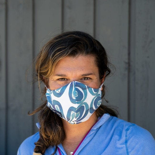 woman wearing cloth face mask with indigo pattern design