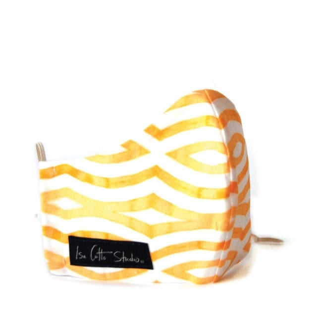 cloth face mask with geometric yellow and white pattern