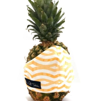 yellow and white geometric pattern with wavy lines styled on a pineapple