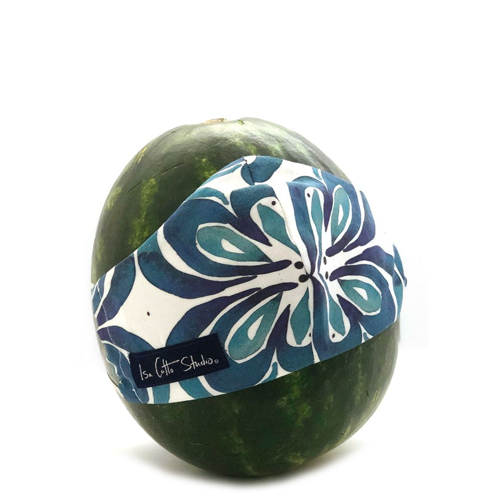 cloth face mask with a geometric indigo pattern on a watermelon