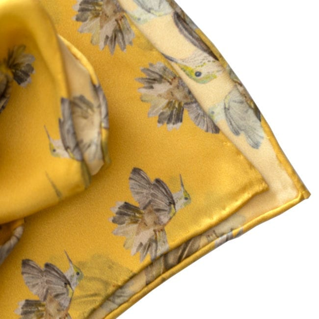 closeup of yellow silk scarf handrolled and handstitched hem