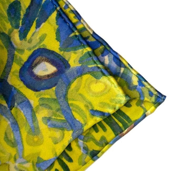 blue and green floral silk scarf showing hand rolled and hand sewn hems