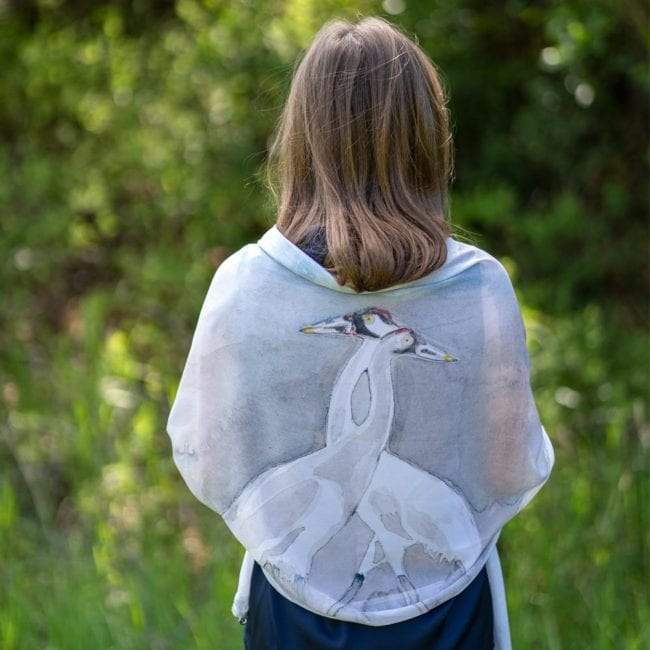 girl turned away from the camera with crane scarf draped around her shoulders
