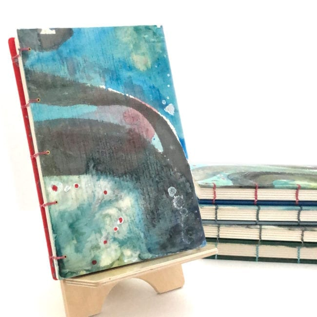 hand-painted journal with aqua blue green background, grey swathes and red dot detail hand-sewn spine