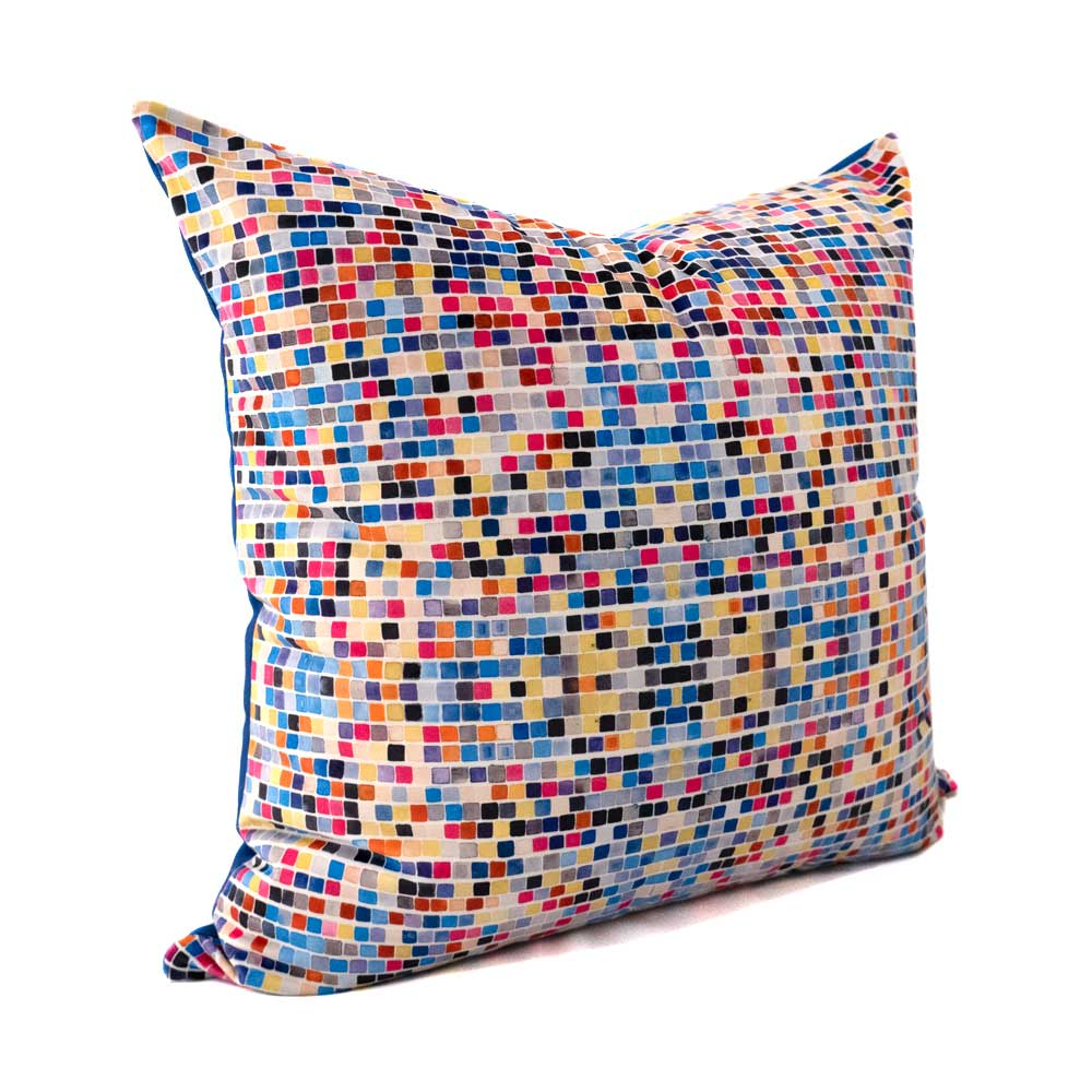 large velvet throw pillow with pink, blue and tan squares