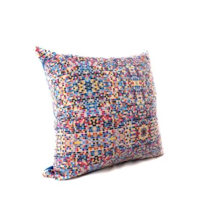 small velvet throw pillow with blue, pink, and tan squares in pattern