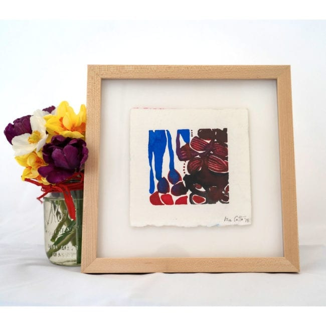 red and blue and purple flower watercolor painting in white cube with purple, yellow, and white flowers
