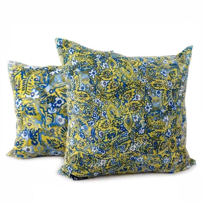 green and blue floral patterned pillows with two different scales of the pattern