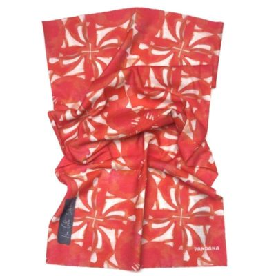 neck gaiter with a poppy image that has been cropped and put into a repeat such that it has a pinwheel effect
