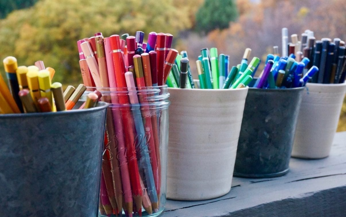 Colored pencils in cups