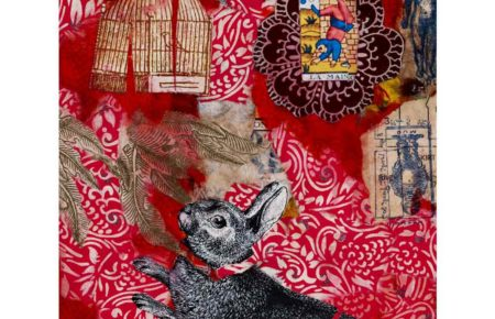 black bunny on red background with bird cage