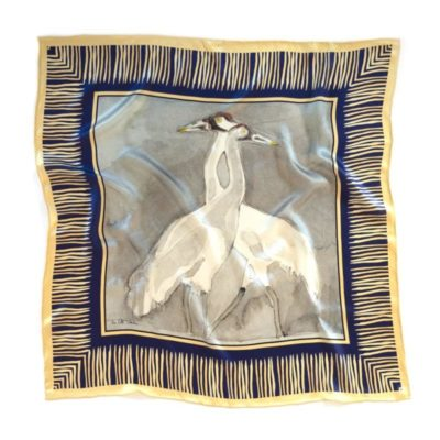 watercolor of two cranes necks intertwined printed on a square silk scarf with a yellow marsh grass border with deep blue background