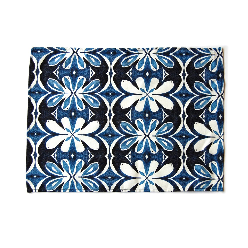 Denim colored lotus pattern placemat on white background.