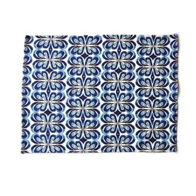 Indigo lotus placemat on white background.