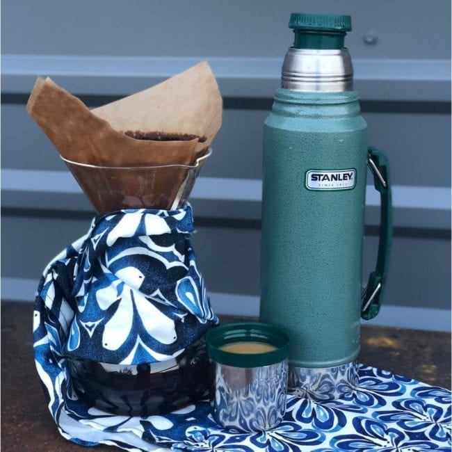 Water bottle sitting on indigo lotus placemat.