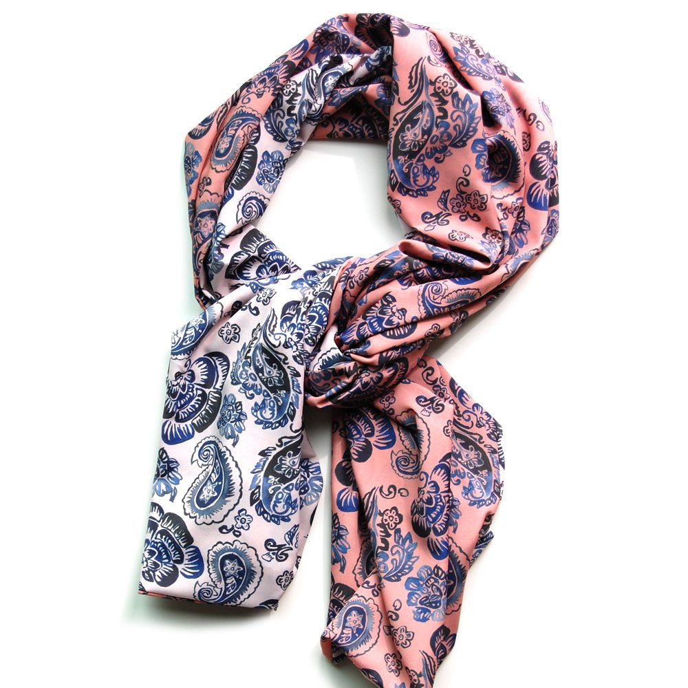 reversible chiffon scarf with light pink paisley pattern on one side and rose pink paisley pattern on the other. scarf is lying on white background and twisted so that both sides are visible