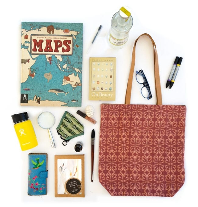 Cloverleaf tote with books, water bottle, face mask and pens