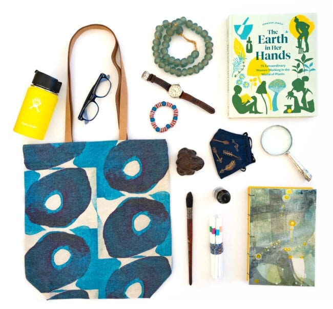Indigo Olives tote bag with notebooks, face mask and water bottle.