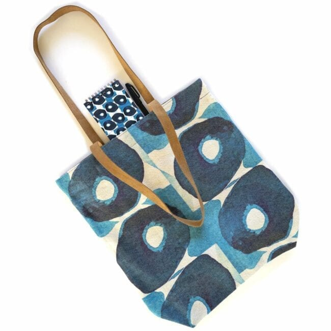indigo olives tote bag and notebook with a pen