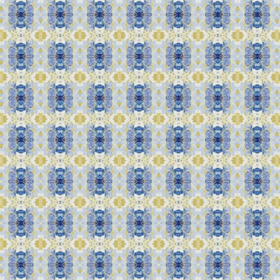Geometric patterned wrapping paper sheet with detailed blue boxes surrounded by more organic gold shapes