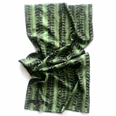 green neck gaiter with organic dark green and grey vine pattern