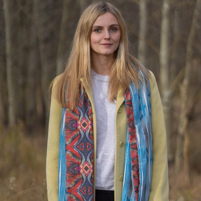 model wearing red bohemian and blue stripe reversible scarf