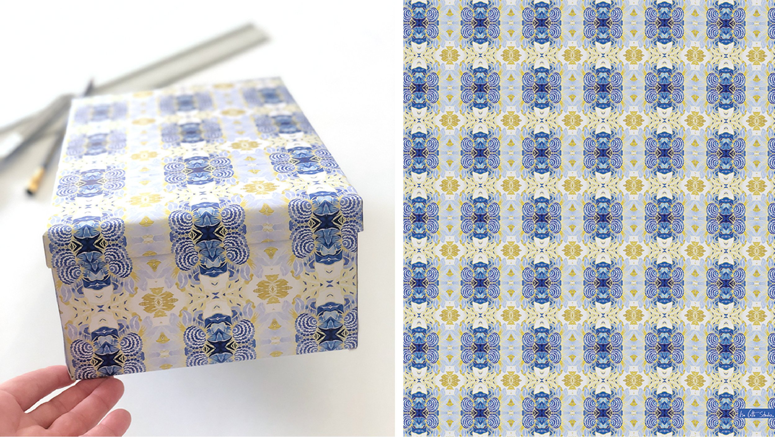 wrapped two-piece box showing how the wrapping paper aligns between the lid and the bottom of the box. wrapping paper is a blue, white and yellow pattern with a kaleidoscope effect