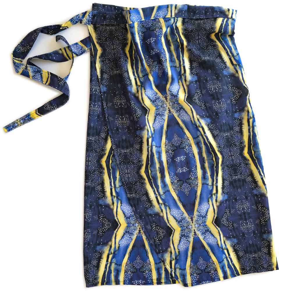 blue and yellow wrap with white dots tied at the waist