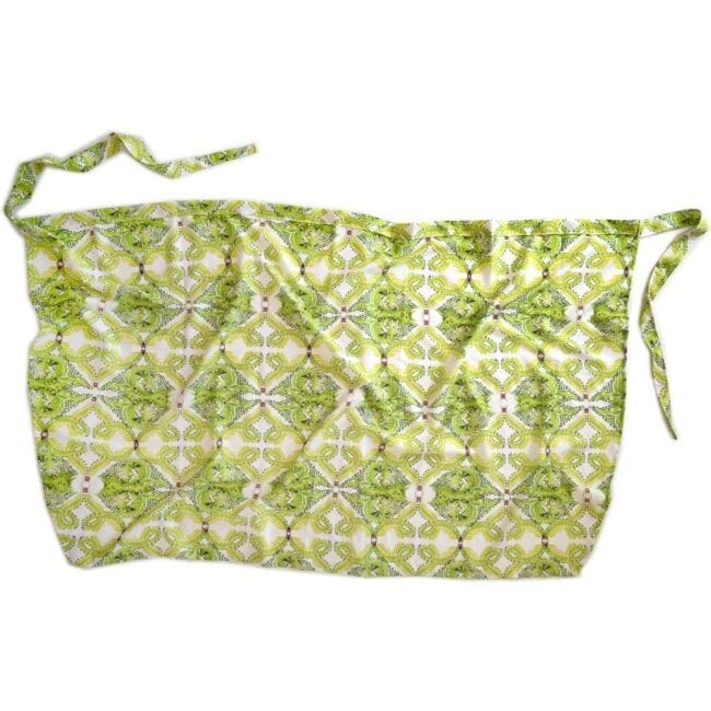 green and white leaf patterned wrap laid flat