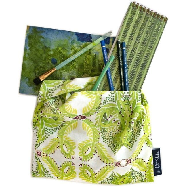 green and white leaf patterned wrap with green vines notebook, green and blue painting and pens