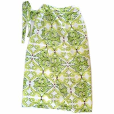 green and white leaf patterned wrap tied at the waist