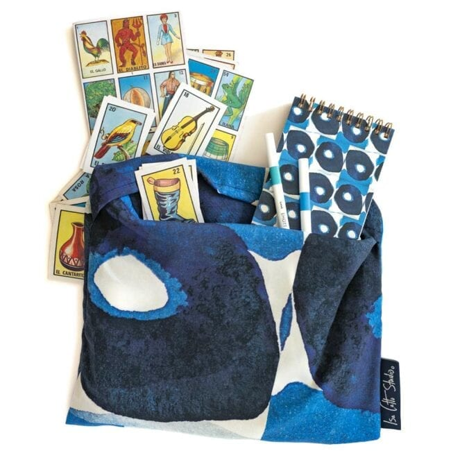 blue and white olive patterned wrap in a pouch with a matching notebook, pens, and cards